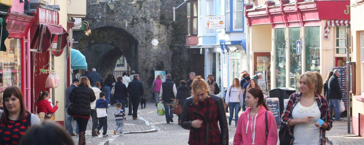 High street footfall - people walking along a street of shops